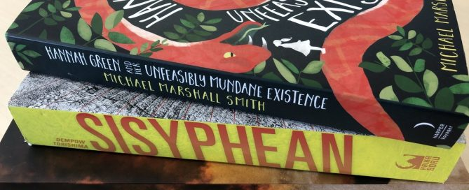 """A pile of books including """"Hannah Green and Her Unfeasibly Mundane Existence"""" (Michael Marshall Smith), """"Sisyphean"""" (Dempow Torishima), and """"City of Lies"""" (Sam Hawke)."""