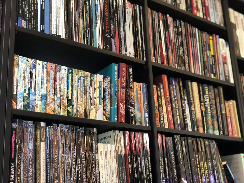 Bookshelf. Top row comics, middle row Terry Pratchett, bottom row D&D.