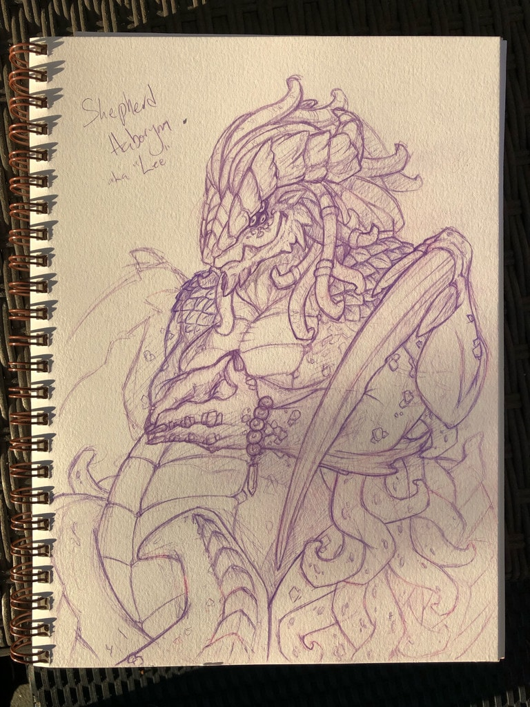 Photo of a sketchbook pages showing a snake-like demon thing.